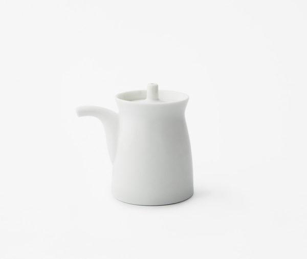 White ceramic soy sauce dispenser