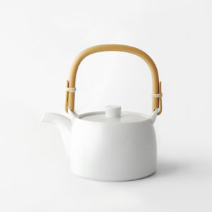 Simple white porcelain teapot with bamboo handle